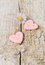 Stock Image : Two pink hearts on wooden background