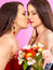 Stock Image : Two sexy lesbian women with flower.