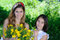 Stock Image : Two sisters with daisies