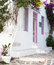 Stock Image : Typical greek house with flowers in the entrance on the cyclades
