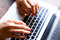 Stock Image : Typing on computer keyboard