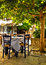 Stock Image : Under tree cafe tables on the village square, Vourliotes, Samos,