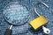 Stock Image : Unlocked padlock and magnifier.