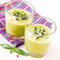 Stock Image : Vegetable cream soup with avocado, herbs, zucchini and black oli