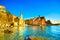 Stock Image : Vernazza village, church, rocks and sea harbor on sunset. Cinque