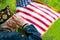 Stock Image : Veteran Salutes the US Flag