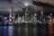 Stock Image : Victoria Harbour, Hong Kong, at night with low clouds