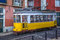 Stock Image : Vintage yellow tram, symbol of Lisbon, Portugal