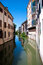 Stock Image : Water canal with reflections in Padova