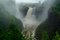 Stock Image : Waterfall on a Foggy Day