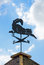 Stock Image : Weather vane on background of blue sky and clouds.