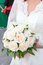 Stock Image : Wedding roses in hands of bride, close-up view
