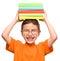 Stock Image :  Weinig jongen houdt een stapel van boeken