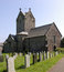 Welsh / English country church. Typical Welsh / English country village church with graveyard, back/sidelit. Gravestones foreground
