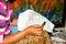 Stock Image : Woman applying wax on batik