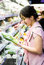 Stock Image : Woman choosing chinese cabbage