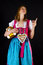 Stock Image : Woman in dirndl pointing at something