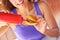 Stock Image : Woman Having Tomato ketchup With Mini burger
