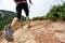 woman hiker legs walking on seaside mountain trail
