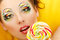 Stock Image : Woman licks candy with beautiful make-up
