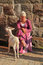 Stock Image : Woman in medieval suit with nanny goat