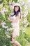 Stock Image : Woman near a bush lilacs