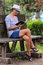Stock Image : Woman reading book in park