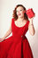 Stock Image : Woman in Red Dress with Gift Box