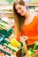 Stock Image : Woman in supermarket shopping groceries