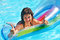 Stock Image : Woman swimming on inflatable beach mattress.