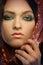 Stock Image : Woman wearing make up. Head shot