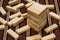 Stock Image : Wooden blocks tower and block spread around