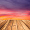 Stock Image : Wooden deck floor over beautiful sunset background.