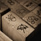 Stock Image : Wooden rubber stamps with meteorology symbol Icons.