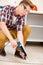 Stock Image : Worker repairing the floor