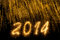 Stock Image : 2014 written in golden sparkling letters
