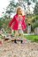 Stock Image : 4 year old girl walking over pebbles