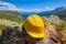 Stock Image : Yellow helmet on a stone