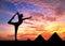 Stock Image : Yoga near Egyptian Pyramids