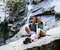 Stock Image : Young Active Hikers Resting Near Waterfalls