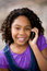Stock Image : Young African American lady on cellphone