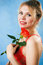 Stock Image : Young beautiful woman with a single red rose