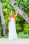 Stock Image : Young beautiful woman in wedding dress on natural backgro