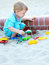 Stock Image : Young boy playing in the sandbox