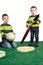 Stock Image : Young boys with huge brush, colour palette and egg