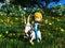 Stock Image : Young cartoon boy riding pet goat.