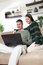 Stock Image : Young couple using laptop