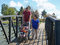 Stock Image : Young family walking on bridge.