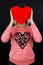 Stock Image : Young girl holding a red heart