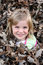 Stock Image : Young Girl in Leaf Pile